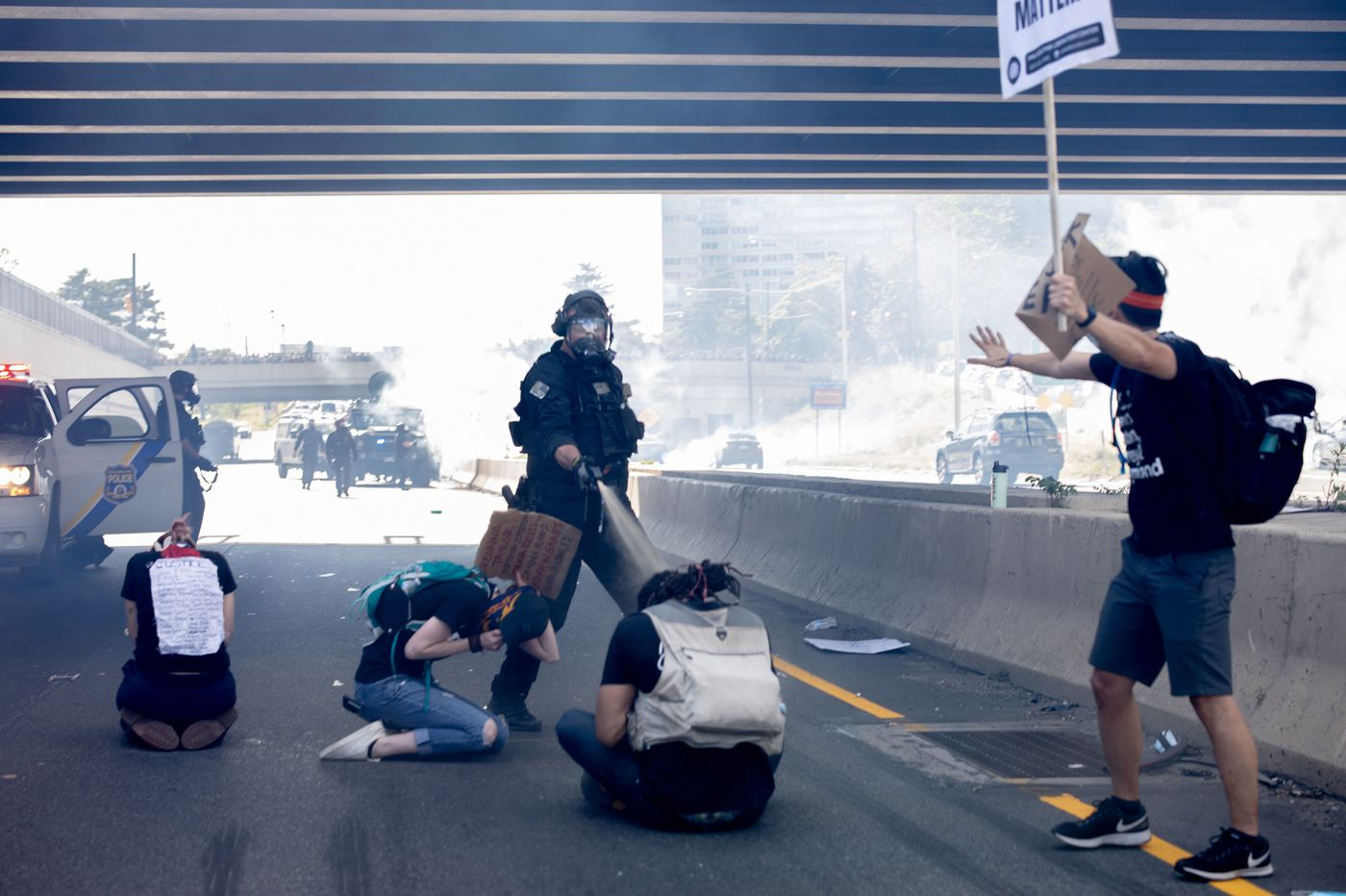Philly SWAT officer seen pepper spraying kneeling protesters on I-676 turns himself in and will be charged