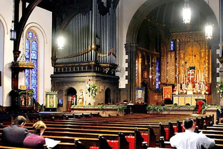 The Low Mass of the Dawn, also called the Shepherds' Mass, at St. Clement's Episcopal Church in Center City was attended yesterday by six worshipers. There is no singing or sermon, and the service lasts only 27 minutes. (Tom Gralish / Staff Photographer)