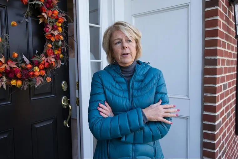 Neighbor Sandy DePhillips speaks with a Philadelphia Inquirer reporter after at least 20 people were injured in a massive, multi-alarm fire at the Barclay Friends senior living community, in West Chester, Pennsylvania, Friday, Nov. 17, 2017. DePhillips assisted seniors with blankets and the use of her cell phone. JESSICA GRIFFIN / Staff Photographer