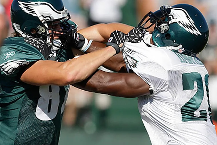 Eagles tight end Brent Celek (left) said he's excited to face Brian Dawkins (right) in a live game. (David Maialetti/Staff file photo)