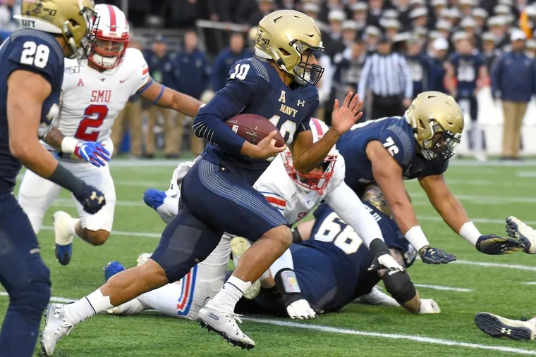 Navy quarterback Malcolm Perry gains yards on a keeper against SMU on Nov. 23.