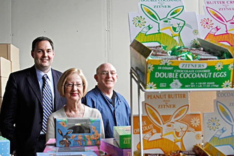 Zitner chief Evan Prochniak (left) stands next to egg display with purchasing manager Gert Palladino and husband Dennis. Prochniak hopes to expand without sacrificing the quality customers crave. MICHAEL S. WIRTZ / Staff Photographer