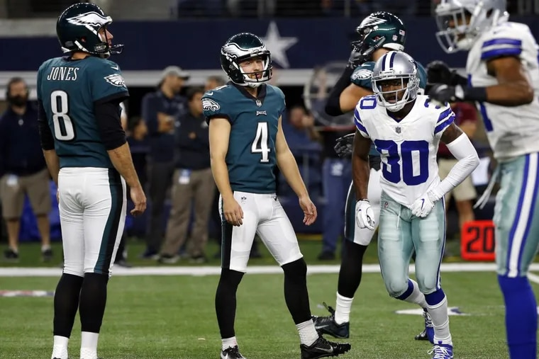 Eagles kicker Jake Elliott (4) and Donnie Jones (left) watch after a missed field goal.