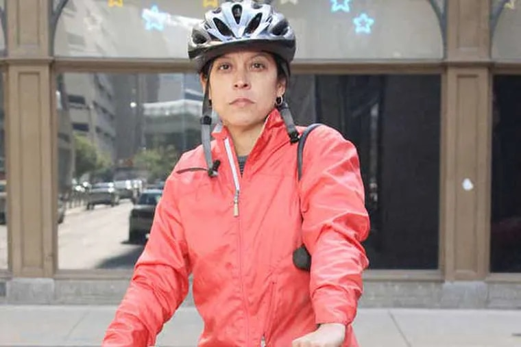 Will the third time be the charm for Daily News columnist Helen Ubiñas to have a successful ride to work on her bike? Maybe. (Jessica Griffin / Staff Photographer)