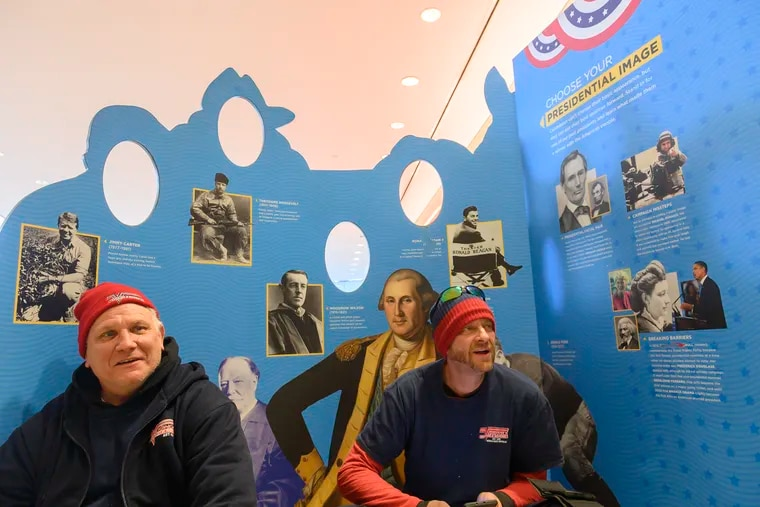 Andy Godown (left) and Brian Burns of Trenton, N.J., speak their opinion on the impeachment of President Donald Trump at the Constitution Center in Philadelphia, Dec. 18, 2019.