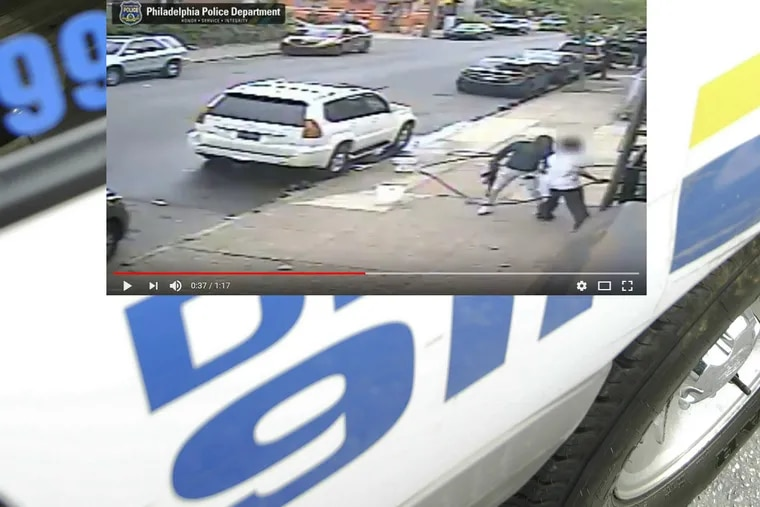 An image from the surveillance video showing the suspect with an AK-47 assault rifle.