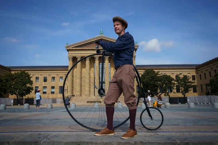 Paul Salter with his penny-farthing bicycle at the Philadelphia Museum of Art.
