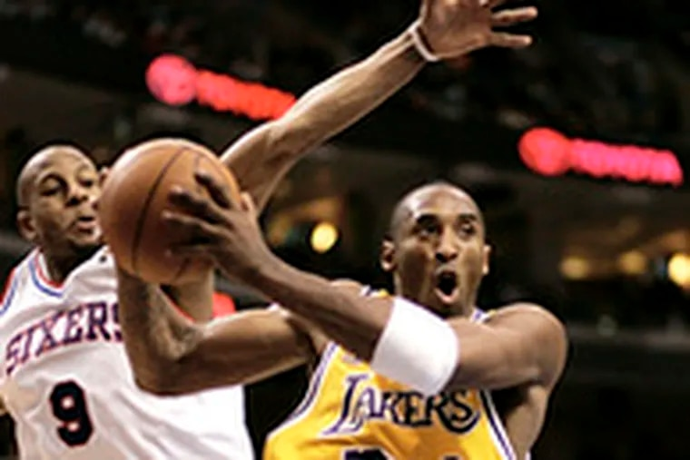 The Lakers' Kobe Bryant drives to the basket ahead of the Sixers' Andre Iguodala. Bryant, the former Lower Merion star, scored 19 points on 6-for-20 shooting. Andrew Bynum led the Lakers with 24 points.