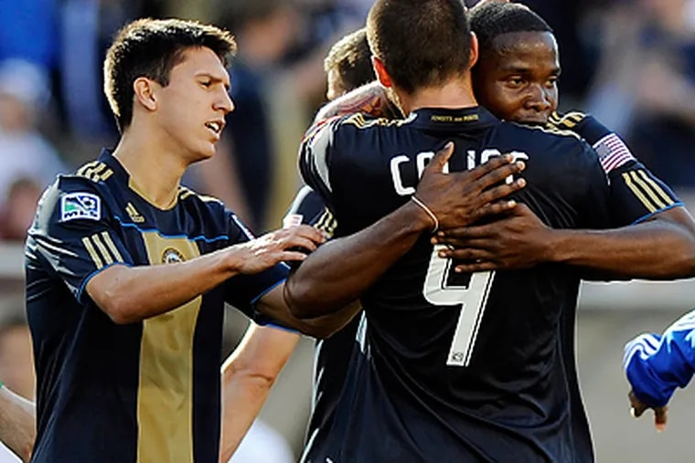 Danny Mwanga, right, is congratulated after his goal in the Union's last game. (AP Photo/Michael Perez)