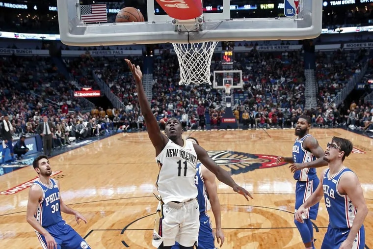 New Orleans Pelicans guard Jrue Holiday (11) goes to the basket in the second half against the Philadelphia 76ers.