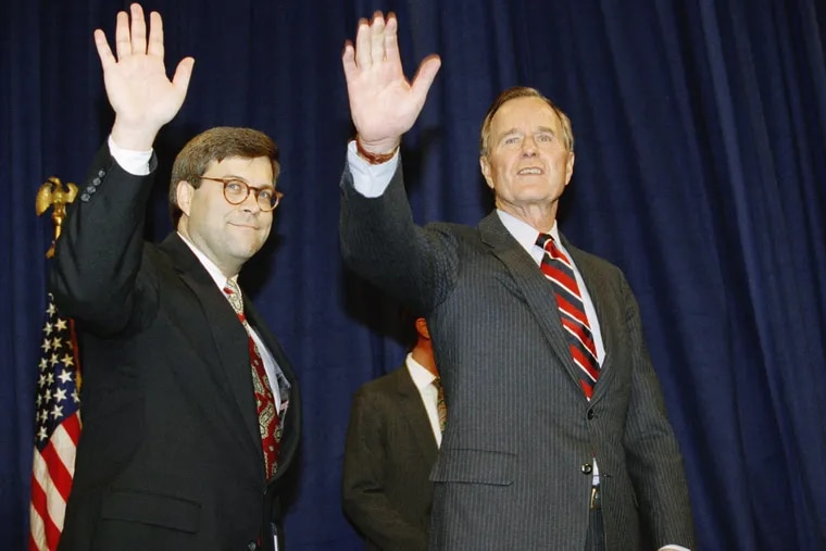 U.S. President George H. Bush, right, and William Barr wave after Barr was sworn in as the new Attorney General of the United States, Tuesday, Nov. 26, 1991 at a Justice Department ceremony in Washington. (AP Photo/Scott Applewhite)