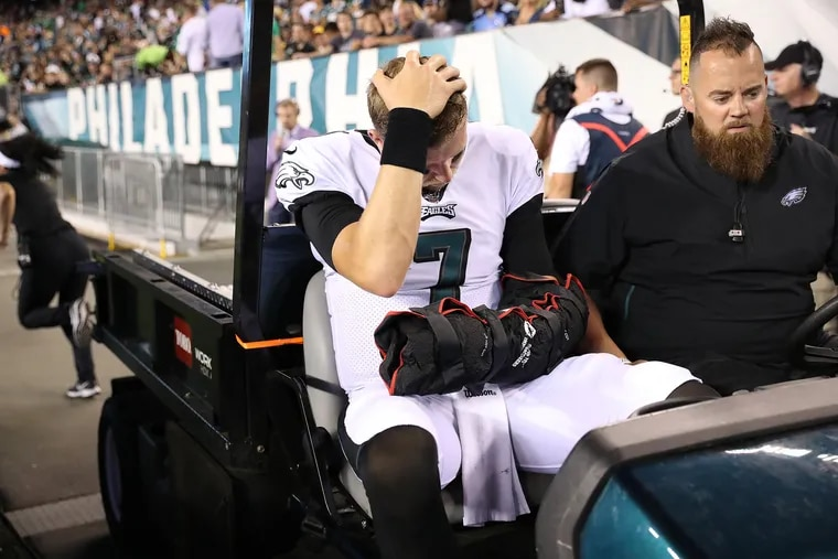 Eagles quarterback Nate Sudfeld is carted off the field after he was injured late in the second quarter Thursday night.