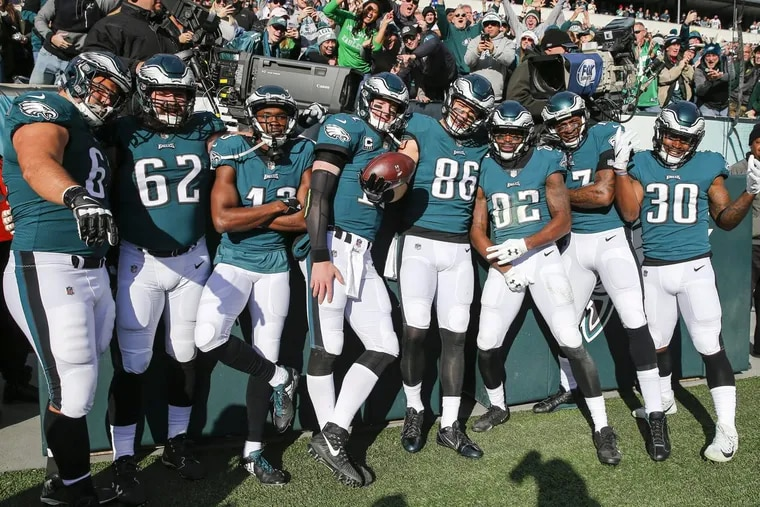 The Eagles' offense celebrates tight end Zach Ertz's first-quarter touchdown against the Chicago Bears during Sunday's 31-3 win.