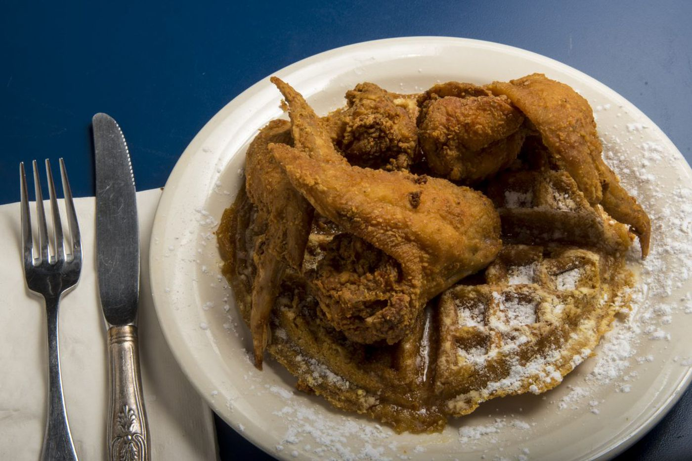 Southern fried chicken over a sweet, savory waffle