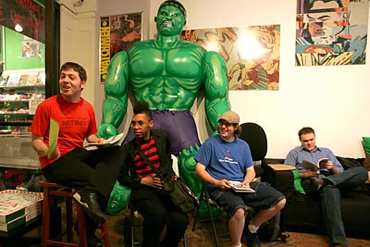 "Comic book fans (from left) Robert LeFevre, Larry West, Matt Johnson, and Shawn McKinney dissect  ""The Nightly News."" (David Swanson / Staff Photographer)"