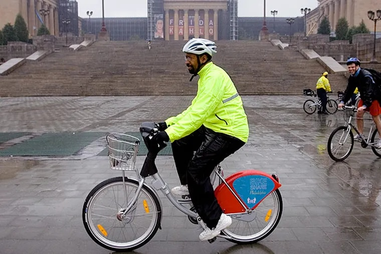 Way back in 2008, Mayor Michael Nutter, rode a bicycle that Bike Share Philadelphia supplied to promote their proposed bicycle-sharing program, at the Philadelphia Museum of Art. (Matt Rourke/AP)