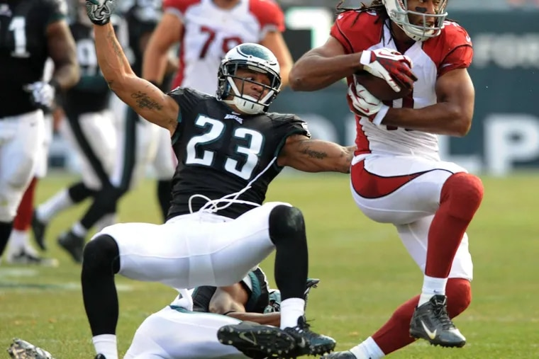 The Cardinals' Larry Fitzgerald breaking free on his wayto a touchdown against the Eagles in 2013 at Lincoln Financial Field. The Eagles won, 24-21.