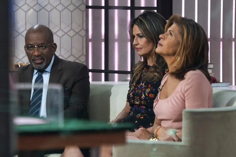 """Co-anchors Al Roker (from left), Savannah Guthrie and Hoda Kotb on the set of the of the """"Today"""" show Wednesday in New York, after NBC News fired host Matt Lauer."""