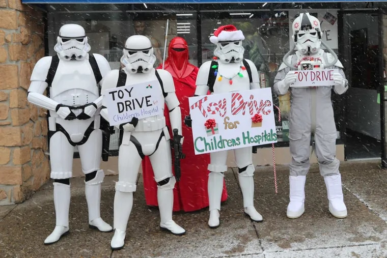 Stormtroopers from Garrison Carida,a Pennsylvania Star Wars Collecting Society, work a toy drive event at Toy and Comic Heaven, Easton Rd, Willow Grove, Pa. on Saturday December 9, 2017.