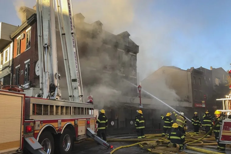 Philadelphia firefighters at at the scene of Bridget Foy's restaurant at 2nd and South Streets around 8 a.m. Wednesday, Oct. 25, 2017.  The fire started at about 1:15 a.m. in the Queen Village neighborhood.