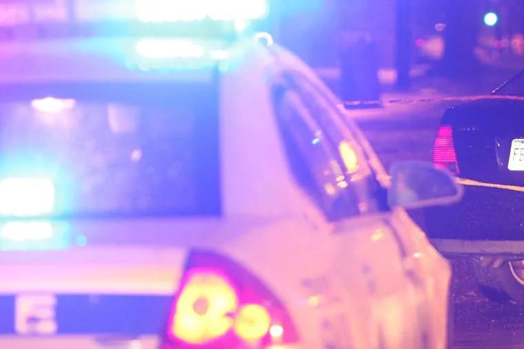 Police scene –  Steven M. Falk / Staff Photographer