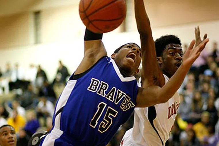 Williamstown's Julian Martin (left) is fouled while shooting by Kingsway's Troy Jenkins (right). (Michael S. Wirtz / Staff Photographer)