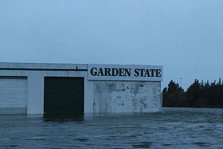 Garden State gas station is partially under water in Pleasantville, N.J. (David Swanson / Staff Photographer)