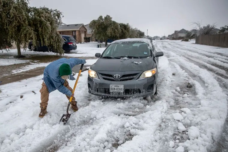 Jose' Nives tries to shovel his way out after getting stuck in the middle of the street. A winter storm that brought snow, ice, and plunging temperatures across Central Texas shut down roads and causing the electrical grid to shut down.