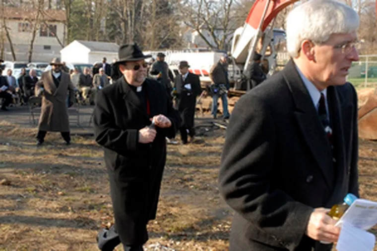 Above, the Rev. George Morris (right), pastor of the United Methodist Church, and the Rev. Patrick Close of Grace Episcopal Church carry anointing oil to pour on the site of the new church, pictured below in an architect's rendering.