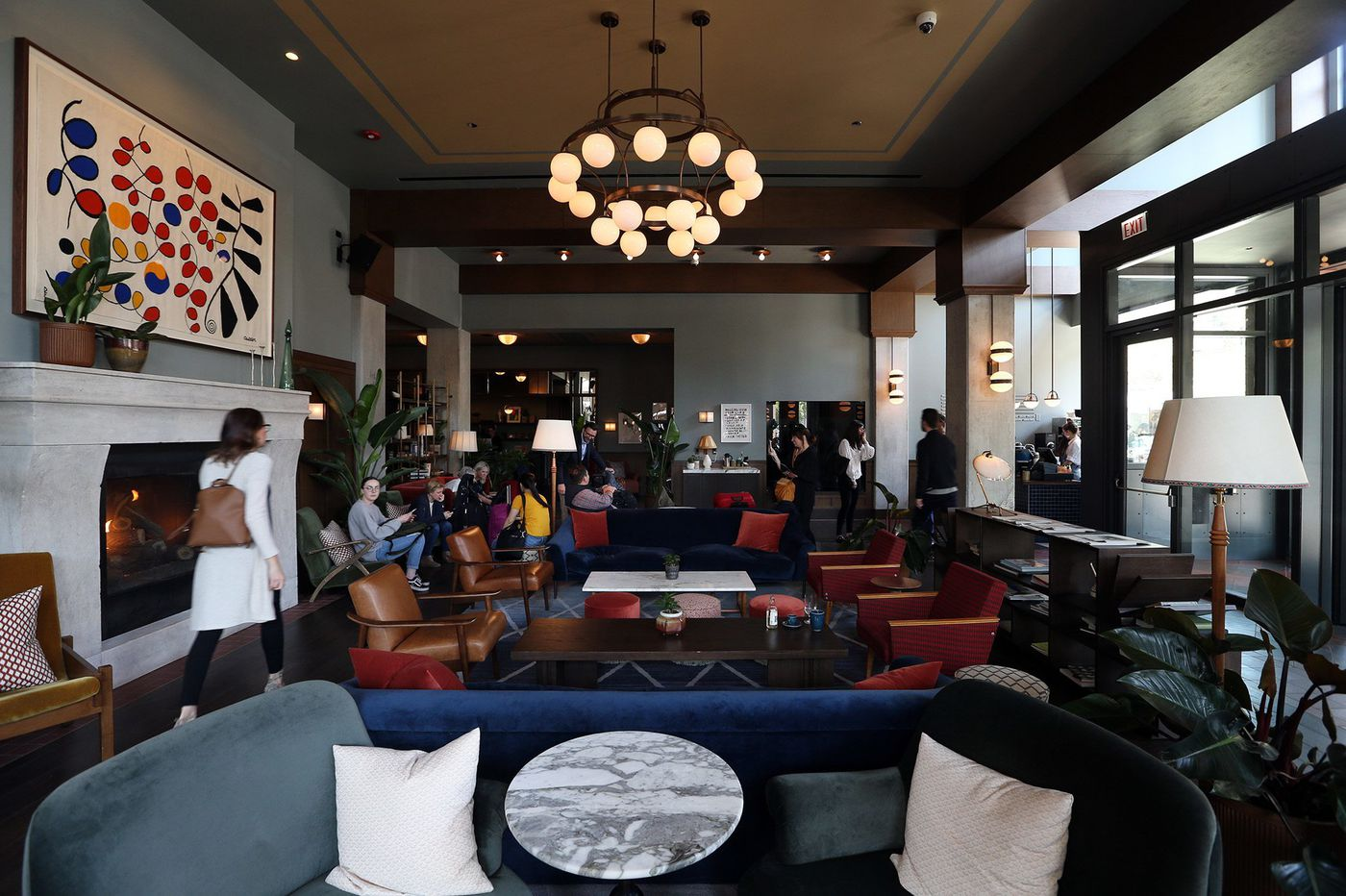 Hotels turned their lobbies into a social hub. Then came the coronavirus.