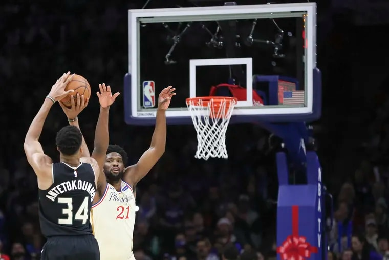 Joel Embiid defends Giannis Antetokounmpo during a 2019 game at the Wells Fargo Center.