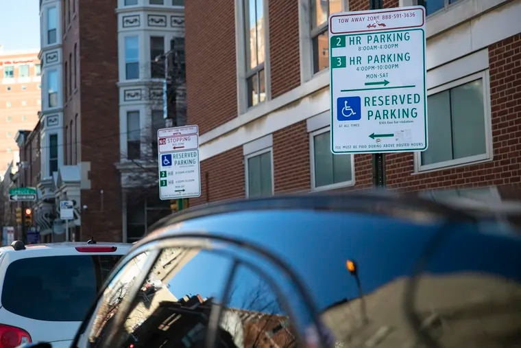 Signs designating parking reserved for disabled drivers mark off a space on the corner of Spruce and Ninth Streets in Philadelphia. The Philadelphia Parking Authority has relocated dozens of disabled parking spots in the process of replacing the parking kiosks in Center City.