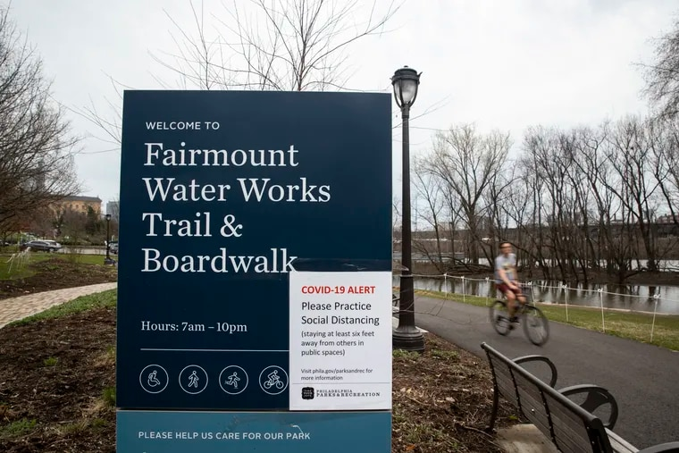 Philadelphia began closing its playgrounds Friday and installing signs warning people to exercise caution when they use the city's parks.