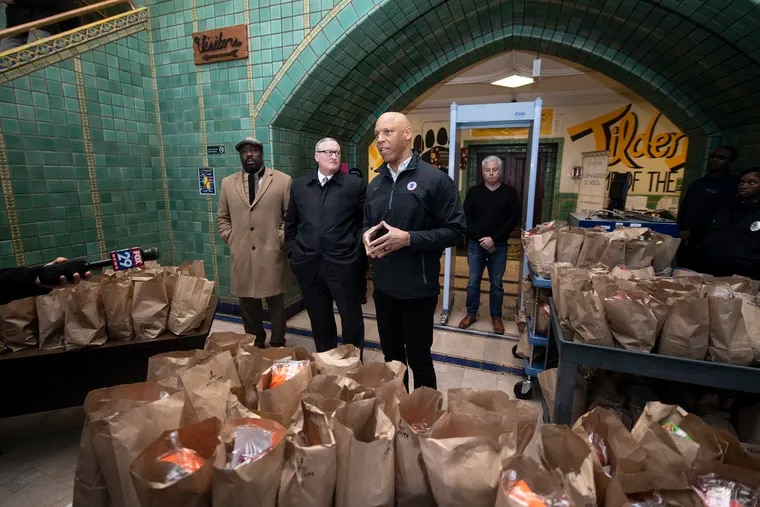 City Councilmember Kenyatta Johnson (left), Mayor Jim Kenney, and Superintendent William Hite visit  Tilden Middle School, one of the sites where families of Philadelphia students can pick up packed breakfast and lunch meals during the coronavirus-related school closure, on Monday, March 16, 2020.