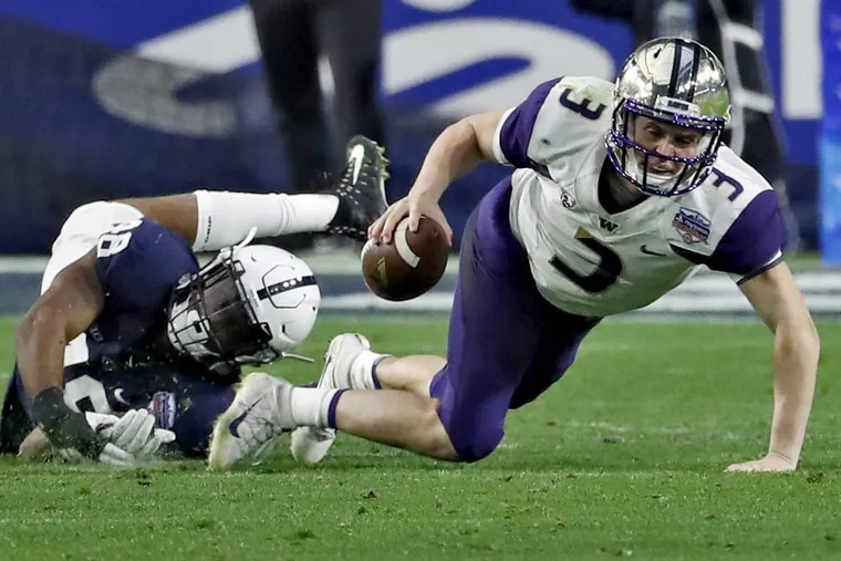 Washington quarterback Jake Browning (3) is tripped up by Penn State defensive end Shareef Miller (48) during the second half of the Fiesta Bowl.