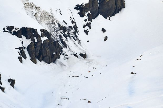 Swiss rescue teams pull several people out after avalanche