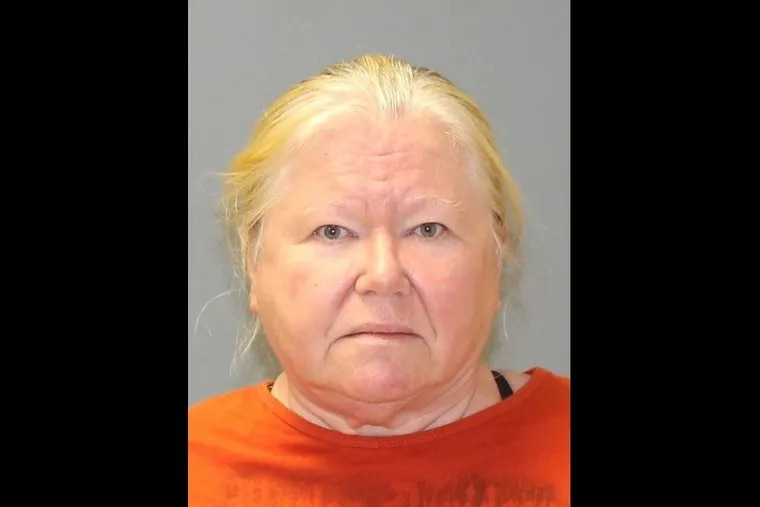 Donna Roberts, 65, was charged with animal cruelty after authorities found 44 dead dogs on her Shamong Township property.