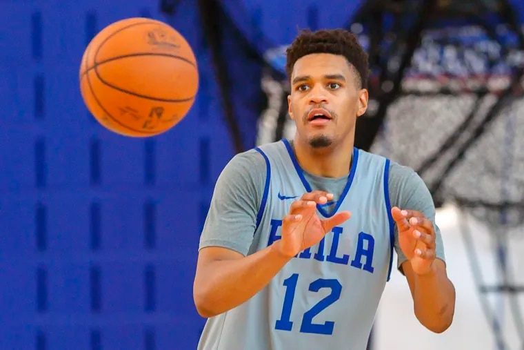 Terry Harris, brother of Sixer Tobias Harris, receives a pass during a shooting drill at a summer league practice at the 76ers practice facility.