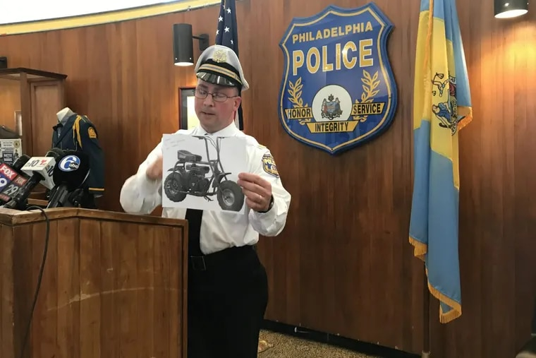 Police Capt. Mark Overwise displays a photo of the type of dirt bike that was being illegally driven by a 26-year-old man, with a 6-year-old boy as his passenger. The boy died after the bike collided with an SUV in West Philadelphia.
