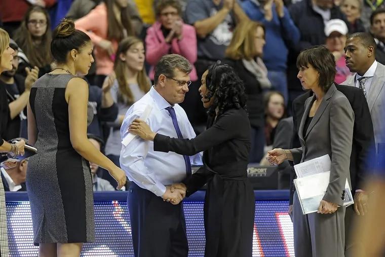 UConn coach Geno Auriemma and South Carolina coach Dawn Staley shake hands after a 2015 game.