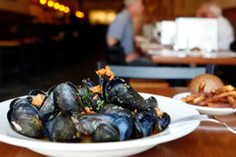 """For the Belgian traditionalists, the mussels are expertly done. """"Drunken"""" mussels are splashed with dubbel and served with chorizo crumbles. And the fries are outstanding."""