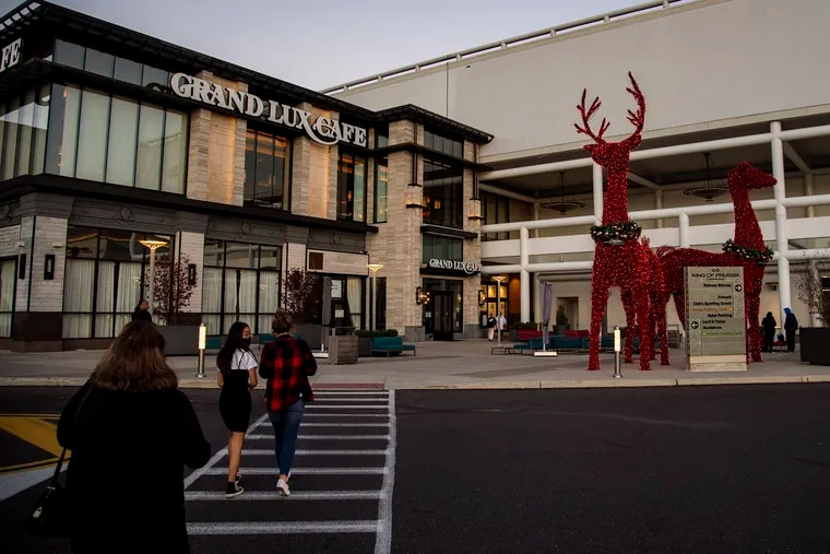 Customers make their way to the mall during black Friday sales at the King of Prussia Mall, In King of Prussia, Pa. Friday, November 27, 2020.