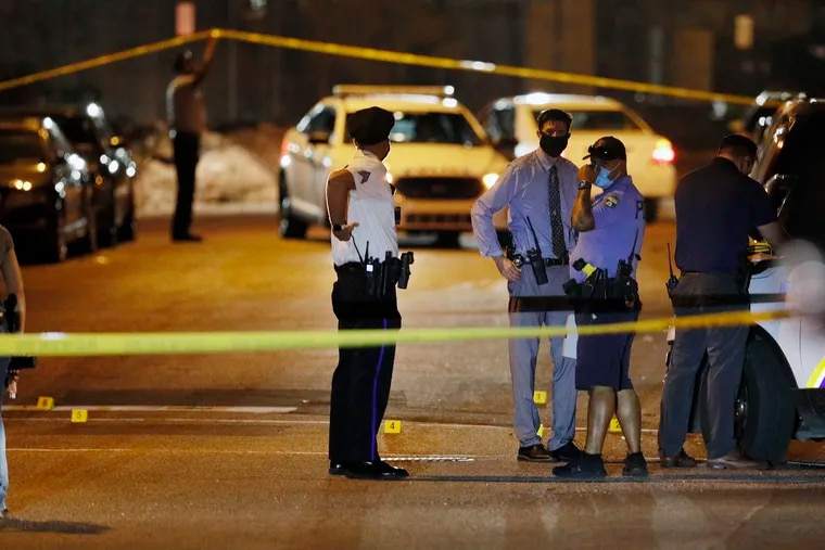 Police investigate the scene around 38th and Poplar Streets, by the Clayborn Lewis Community Center Playground, where six people were shot just before 9:30 p.m. Saturday. A half hour later an 11-year-old boy became the 101st kid shot in the city this year, sustaining a graze wound to the head and shoulder near Olney Playground.