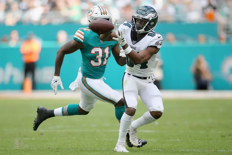 Eagles wide receiver Greg Ward (84) makes a catch in front of Miami Dolphins cornerback Ken Webster on Dec. 1.