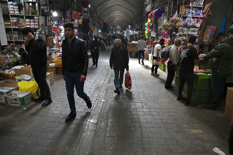 People walk through Tehran's Grand Bazaar in Iran. Some Iranians welcomed the election of Joe Biden as the 46th president of the United States as a beacon of hope for the future of their country already battered by the most severe sanctions in its history.