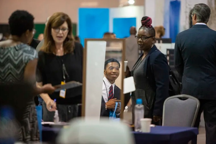 People attend the Pennsylvania Convention Center for the Hire! Philly Job and Resource Fair on Thursday, Oct. 04, 2018.