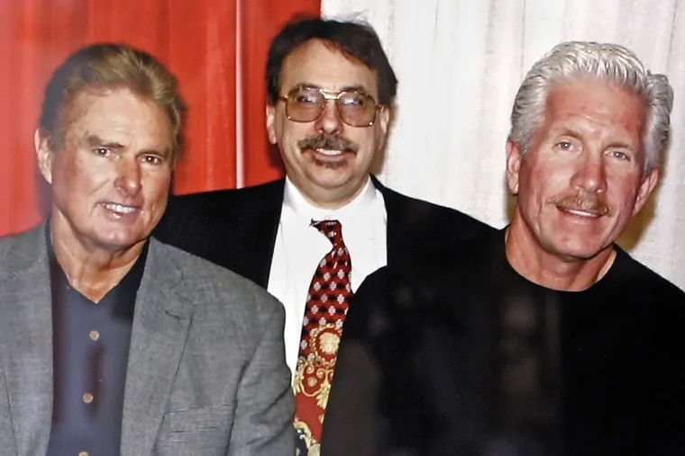 DePace Sports Museum co-owner Nick DePace (center) with Phillies greats Steve Carlton (left) and Mike Schmidt in an undated photo, which hangs in the DePace Sports Museum in Collingswood.