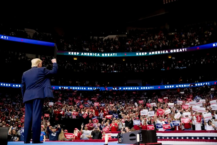 President Donald Trump takes the stage at a campaign rally at American Airlines Arena in Dallas on Oct. 17.