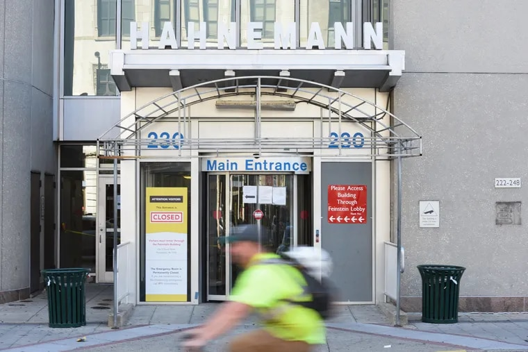 The main entrance of Hahnemann University Hospital with a closed sign on the window located at Broad and Vine Streets.