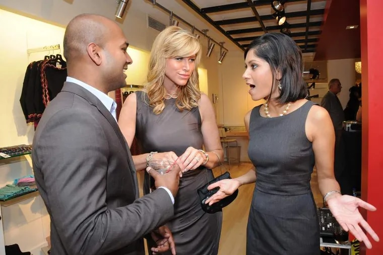 inqlings27  Photo: HUGHE DILLONTalking shop at the relaunch party for the Boyds store in Center City on Thursday 9/24, NBC10's Mac Francis chats with CBS3's Lesley Van Arsdall (center) and NBC10's Aditi Roy.
